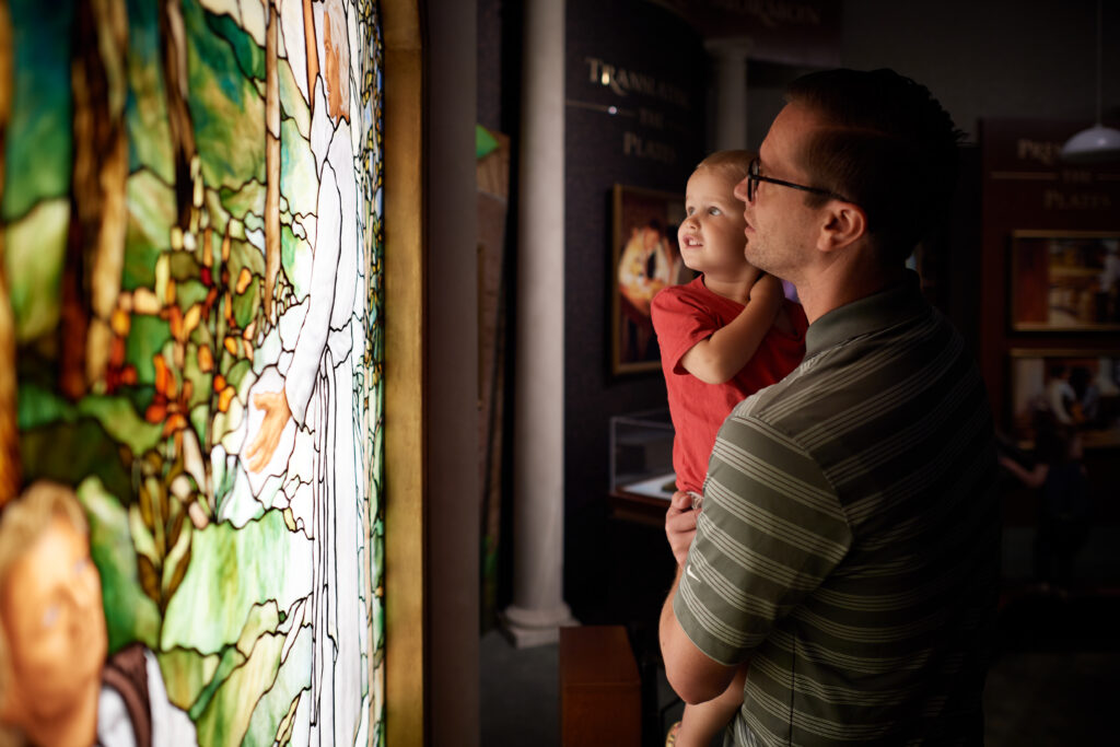 A father and child look at a stained glass mural in the Hill Cumorah Visitors' Center in Manchester, New York, in August 2018. The Hill Cumorah is where Joseph Smith met annually with the angel Moroni from 1823 to 1827 and received the gold plates.