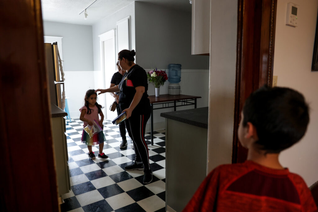 Lucy Navas, her children, Allison Contreras Navas, 6, and Christopher Contreras Navas, 7, and her mother, Dinora Navas, prepare leave their new apartment so Lucy Navas can go to work in Medford, Oregon, on Tuesday, Sept. 22, 2020. Lucy Navas, her two children and her parents lived together in a mobile home that burned to the ground in the Almeda Fire. Now they are sharing a two-bedroom apartment provided by a fellow member of The Church of Jesus Christ of Latter-day Saints.