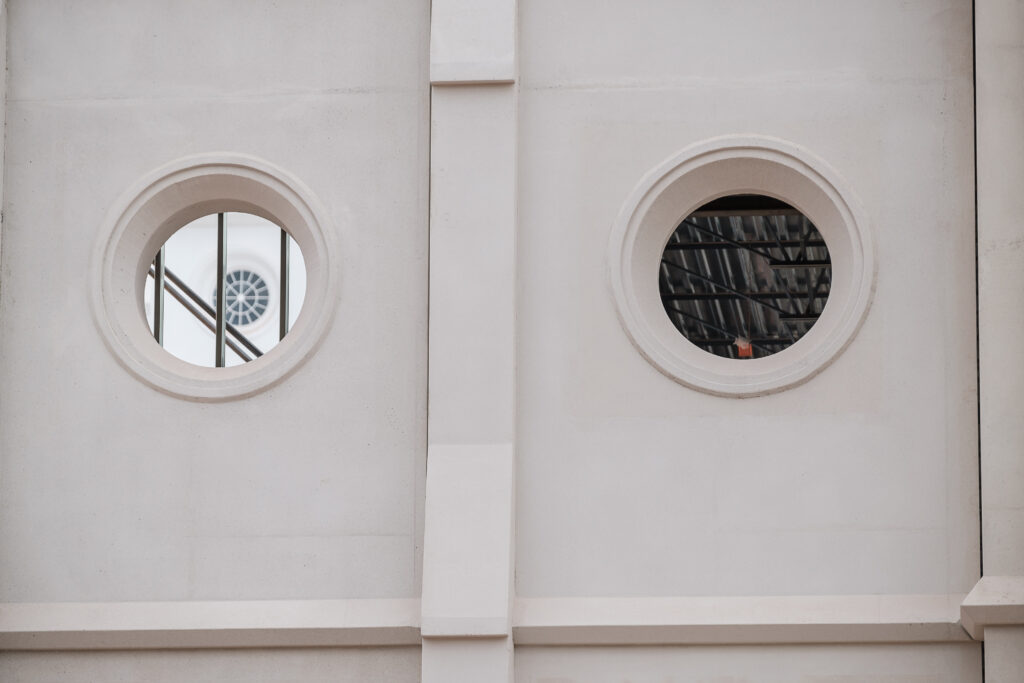 Unfinished windows on the outside of the new north entrance to the St. George Utah Temple of The Church of Jesus Christ of Latter-day Saints mimic those of the original temple, seen through the left window, on Friday, Nov. 6, 2020, in St. George. The historic temple is undergoing renovations that are expected to be completed in 2022.