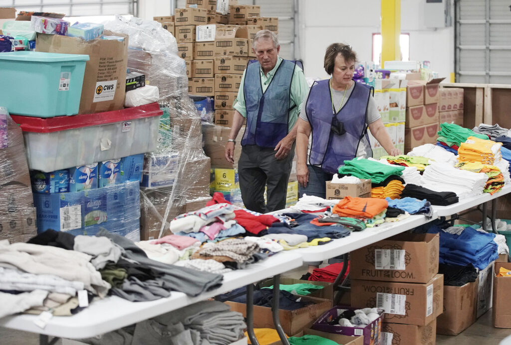 Elder Jim Anderson, left, and Sister Karyn Anderson, Latter-day Saint service missionaries, look over donated items for refugees at the Family Transfer Center in Houston on Monday, June 7, 2021. The center provides a temporary respite for families who have been cleared at the U.S. border and need short-term shelter and food. The creation of the Family Transfer Center is the result of a collaboration between The Church of Jesus Christ of Latter-day Saints, Catholic Charities, the National Association of Christian Churches, YMCA International Services, Texas Adventist Community Services, Houston Responds and The Houston Food Bank.