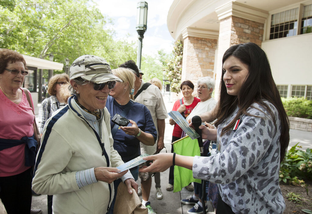 Sister Elisa Carrus hands out pamphlets to Italian visitors on a Temple Square tour in Salt Lake City, Tuesday, June 14, 2016.