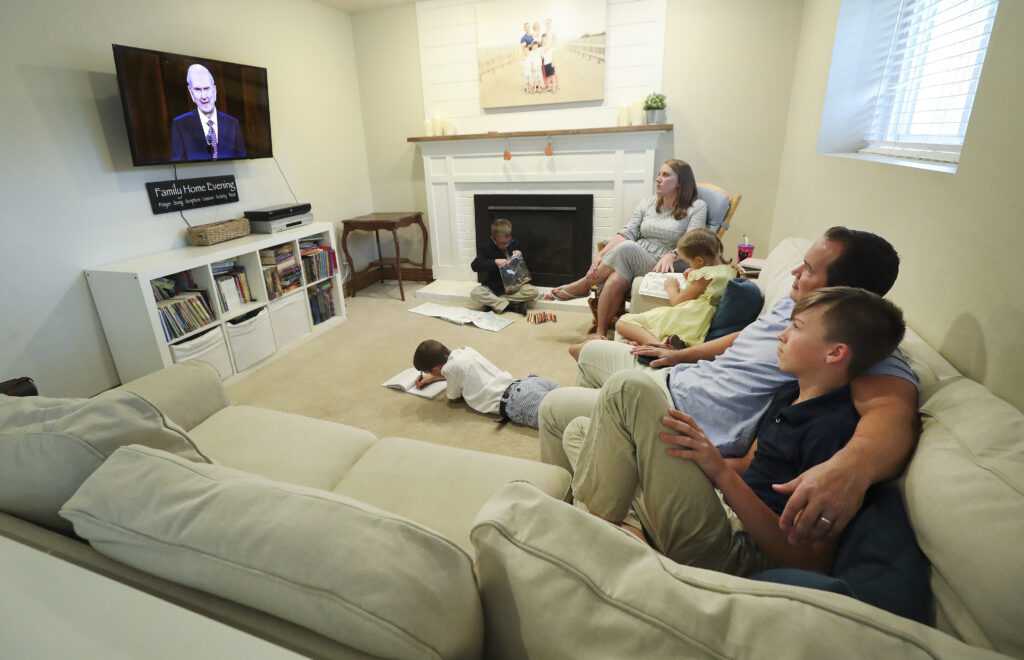 Nathaniel and Felicity Hancock,along with their children William, Cameron, Andrew and Hannah, watch from their home in Sandy as President Russell M. Nelson speaks during 190th Semiannual General Conference of The Church of Jesus Christ of Latter-day Saints in Sandy on Saturday, Oct. 3, 2020.
