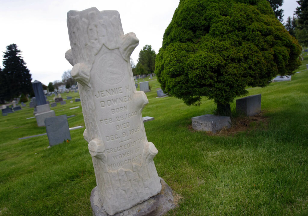 A headstone designed to look like a tree is one of the uniquely shaped monuments at the Salt Lake City Cemetery, shown on Sunday, May 23, 2010.
