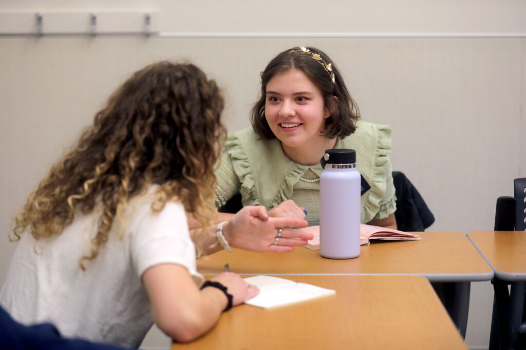 Sister Audrey Morgenegg and Sister Elizabeth Wheatley discuss a lesson during their first in-person class at the Provo Missionary Training Center in Provo on Wednesday, Aug. 18, 2021.