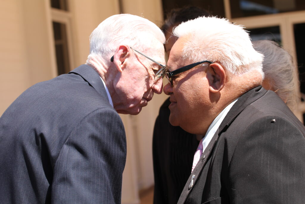Elder Glen L. Rudd greets Heta Haihai with a Maori hongi, a traditional Maori greeting in which people press their noses together, at Temple View, New Zealand, in February 2014.
