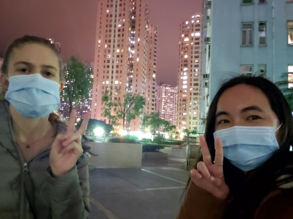 Sister LInda Hsiung of the China Hong Kong Mission pauses for a nighttime photo with a fellow missionary. The photo is one she included as a submission to the Church History Department's project of documenting missionary experiences during the 2020 COVID-19 pandemic, which drew 7,000 online entries from missionaries and mission leaders worldwide.