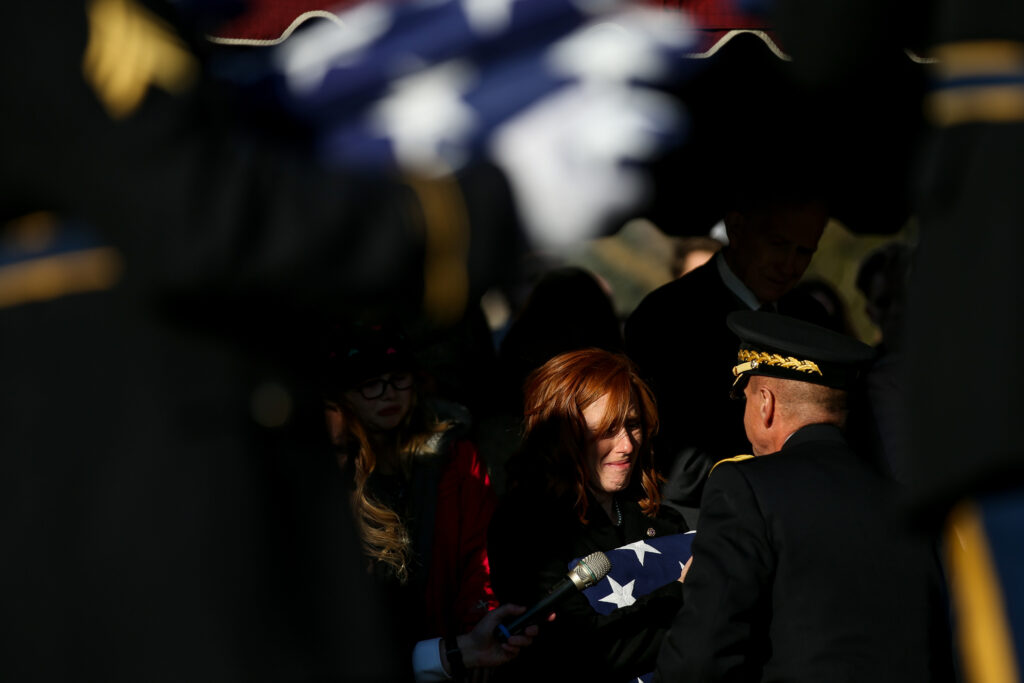 Jennie Taylor, wife of Maj. Brent Taylor, is presented with a folded American flag by Maj. Gen. Jefferson S. Burton during Maj. Taylor's interment at the Ben Lomond Cemetery in North Ogden on Saturday, Nov. 17, 2018.