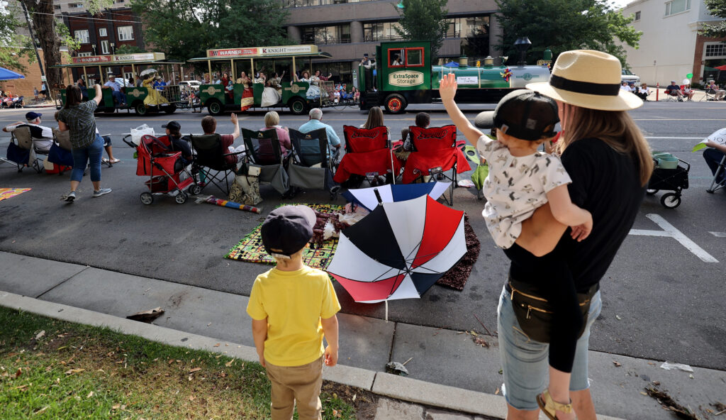 Levi Ferguson, left, and his mom, Meleah Ferguson, holding sister Ella, watch the Days of '47 Parade in Salt Lake City on Friday, July 23, 2021.