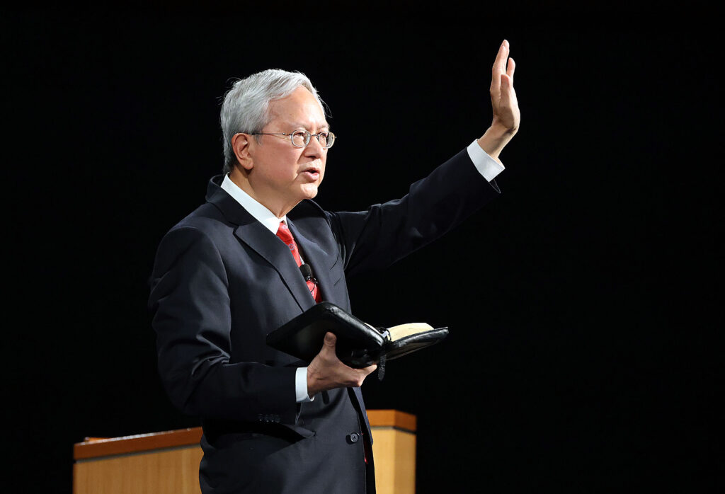 Elder Gerrit W. Gong, of the Quorum of the Twelve Apostles, holds scriptures as he speaks to missionaries for a devotional broadcast at the Provo Missionary Training Center in Provo, Utah, on Tuesday, Sept. 21, 2021.