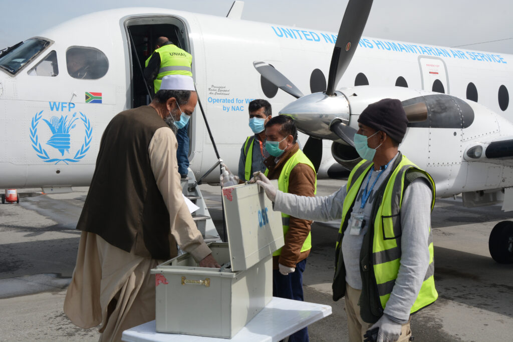 Staff and Passengers of UNHAS prepare for a flight and check in on April 5, 2020 at Kabul International Airport. All staff and passengers' body temperature is taken upon entering the UNHAS terminal and they wash hands and disinfect before entering the check in building prior to boarding the plane as precautions against the coronavirus.