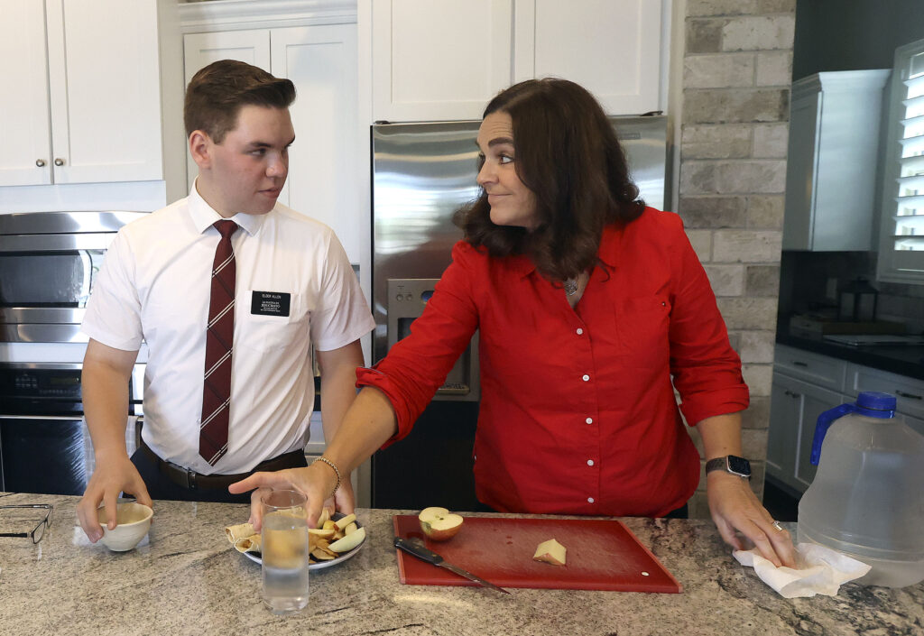 Elder Clint Allen, Jr., and his mother Sheri Allen make lunch during a break between Elder Allen's missionary training sessions at home in Chandler, Ariz., on Thursday, Aug. 12, 2021. Elder Allen is doing missionary training from home for a couple weeks before finishing training in person at the Provo Missionary Training Center.