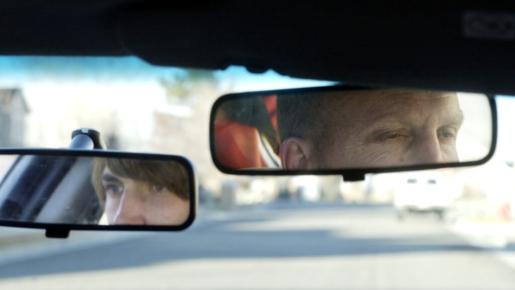 A high school driver's education instructor, right, takes a student driver on the road Wednesday, Jan. 29, 2003, in Murray, Utah.