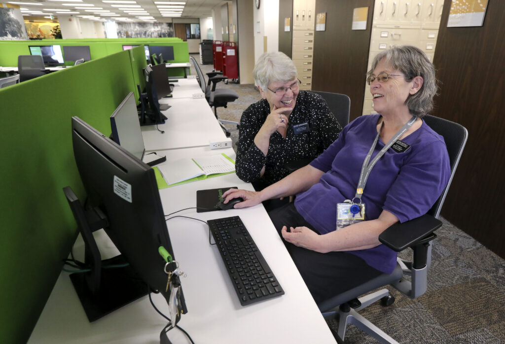 Sister Pamela Sheffield and Sister Vergie Scroughams work on the second floor of The Church of Jesus Christ of Latter-day Saints' newly remodeled Family History Library in Salt Lake City on Tuesday, June 29, 2021.