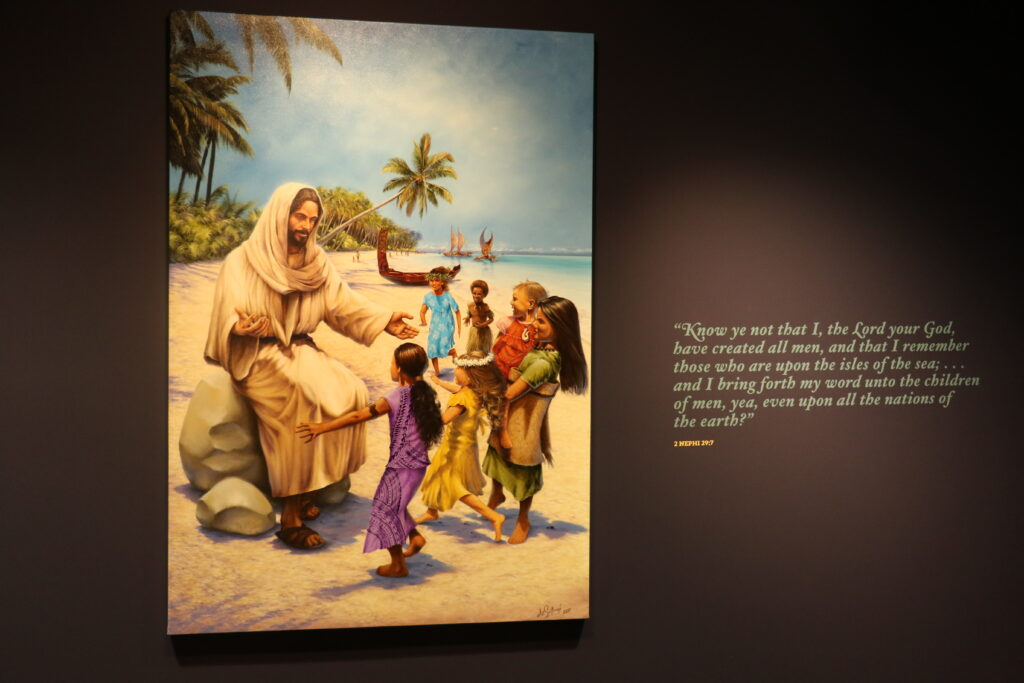 A painting by Dave Sotogi depicting the Savior with the children of the Pacific islands hangs in the museum portion of the Matthew Cowley Pacific Church History Center in Hamilton, New Zealand.