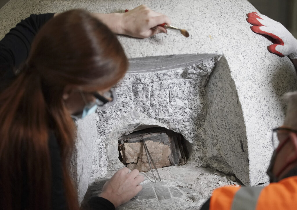 Emiline Twitchell, conservator at the Church History Library, removes items from the Salt Lake Temple capstone time capsule in Salt Lake City on Wednesday May 20, 2020.