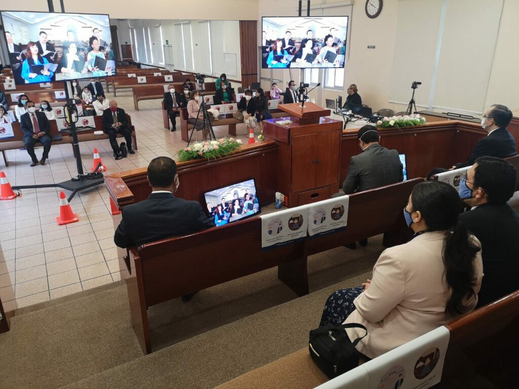 A view from the rostrum during a September 2020 stake conference session of the Puebla Mexico Fuertes Stake shows a handful of in-person attendees and monitors used for videoconferencing.