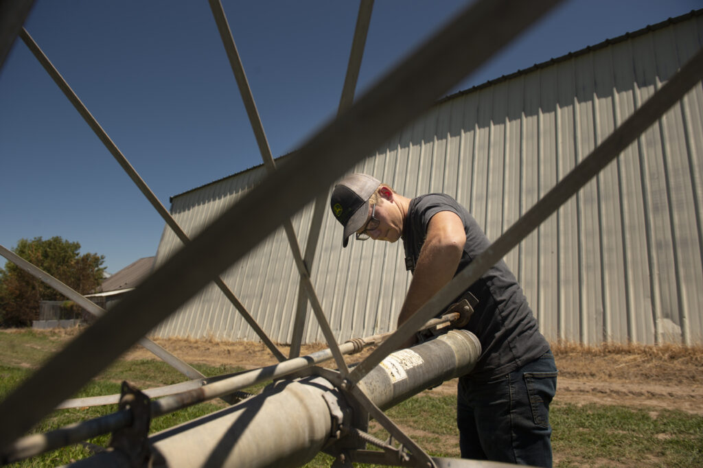 Elder Garrett Mill works on a wheel line during his shift Saturday, July 18, 2020, at Idaho Falls Crops, a welfare farm of The Church of Jesus Christ of Latter-day Saints south of Idaho Falls, Idaho.