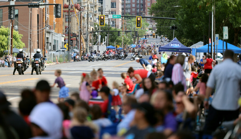 Spectators watch as the Days of '47 Parade kicks off in Salt Lake City on Friday, July 23, 2021.