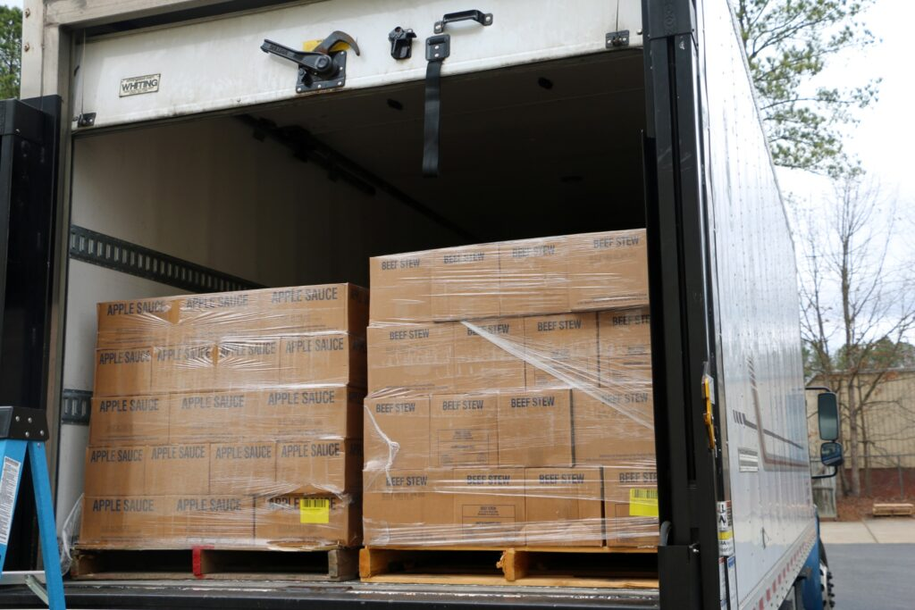 Pallets of food that will be donated to inner-city churches in Richmond, Virginia, are delivered to the bishops' storehouse Tuesday, March 3.