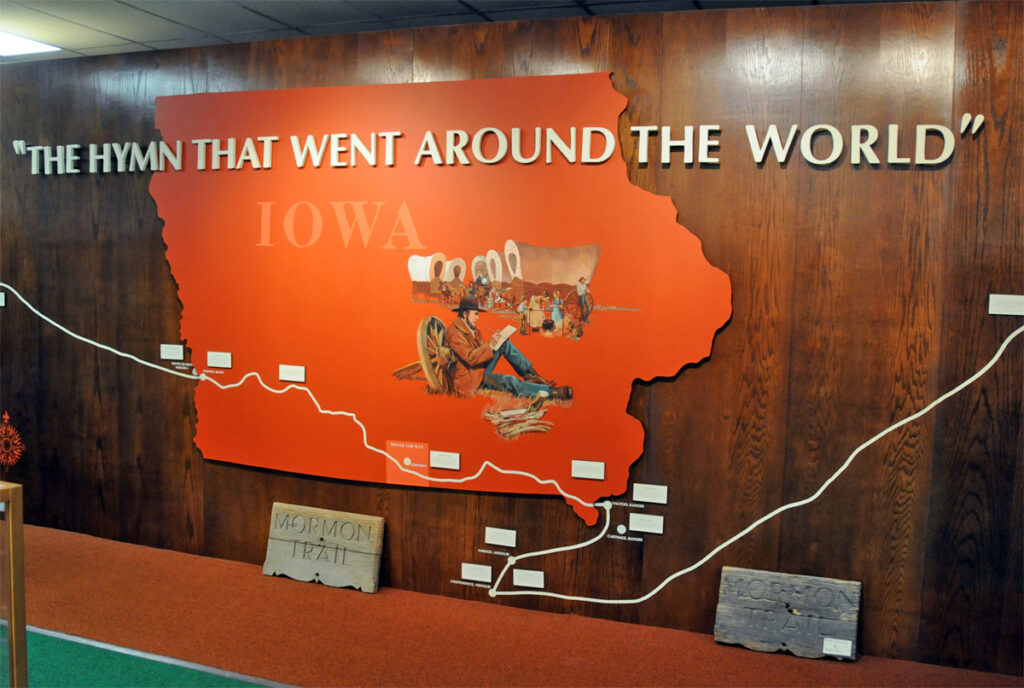 """The Prairie Trails Museum of Wayne County, Iowa, is in Corydon, Iowa. It shares an exhibit about """"Come, Come Ye Saints"""" which was penned at a campsite near theTharp Cemetery, which is situated just above Locust Creek."""