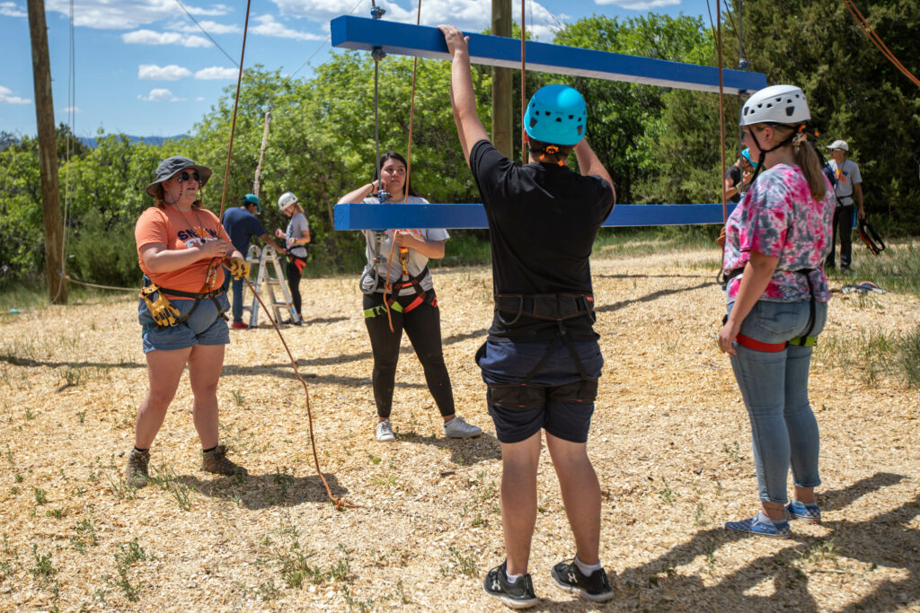 Left to right, guides Maris Jones and Juanita Gomez instruct participants Tyson Laws, 15, and Kalani Rhodes, 17, on how to do a climbing activity at Badger Mountain in Ephraim Canyon, Utah, for the Snow Fun! Youth Conference on Thursday, June 3, 2021.