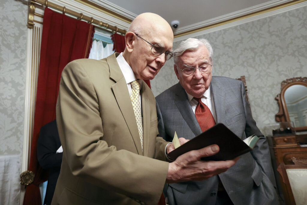President Dallin H. Oaks, first counselor in the First Presidency, and President M. Russell Ballard, acting president of the Quorum of the Twelve Apostles, look through Anthon H. Lund's journal from 1918 while touring Joseph F. Smith's bedroom in the Beehive House in Salt Lake City on Friday, Sept. 24, 2021. President Ballard and Sister Kristen M. Oaks are descendants of Joseph F. Smith.