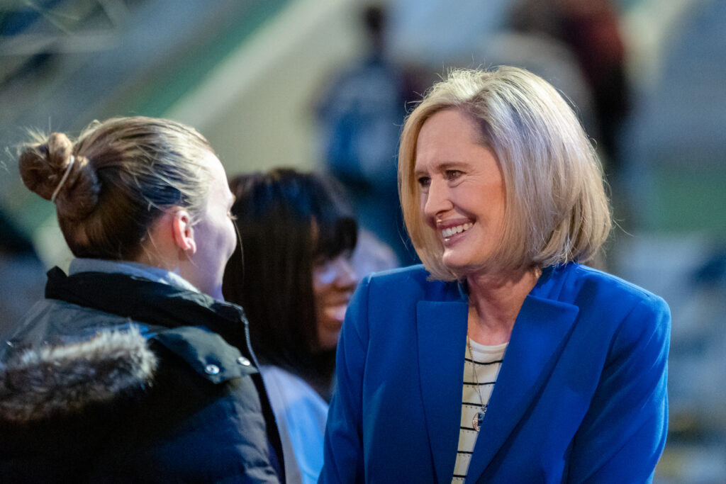 Young Women general president Sister Bonnie H. Cordon speaks with a devotional attendee after speaking at Brigham Young University's Marriott Center on Feb. 4, 2020.