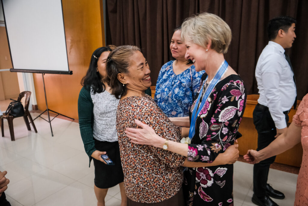 President Jean B. Bingham hugs a member of the Relief Society following a meeting with local Relief Society leadership in Manila, Philippines, on Feb. 2, 2020.