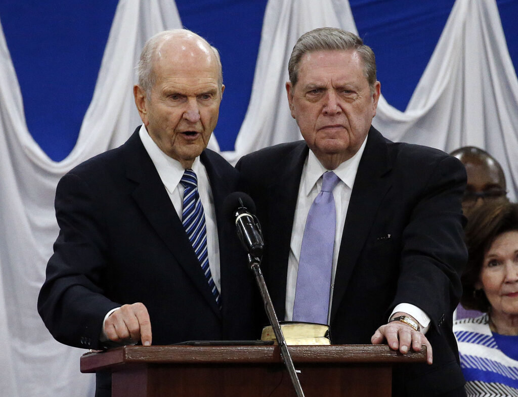 President Russell M. Nelson, president ofThe Church of Jesus Christ of Latter-day Saints, and Elder Jeffrey R. Holland, of the Quorum of the Twelve Apostles, stand together as President Nelson gives a blessing during a special devotional in Nairobi, Kenya, on Monday, April 16, 2018.