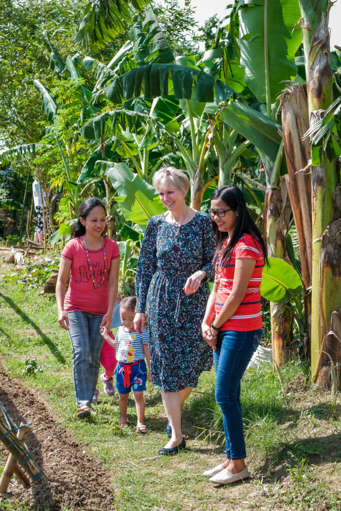 Sister Jean B. Bingham walks through the Batiles family's garden during a visit to Catarman, Philippines, on Feb. 3, 2020.