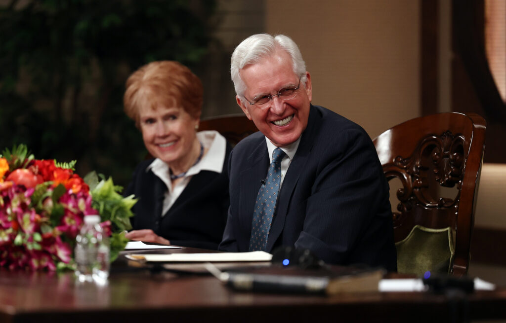 Elder D. Todd Christofferson of the Quorum of the Twelve Apostles and his wife, Sister Kathy Christofferson, laugh as they join President Dallin H. Oaks of the First Presidency of The Church of Jesus Christ of Latter-day Saints and his wife, Sister Kristen Oaks, in a conversation while recording a March 14 Spanish-language young adult devotional that was taped at the Church Office Building in Salt Lake City on Friday, Feb. 26, 2021.