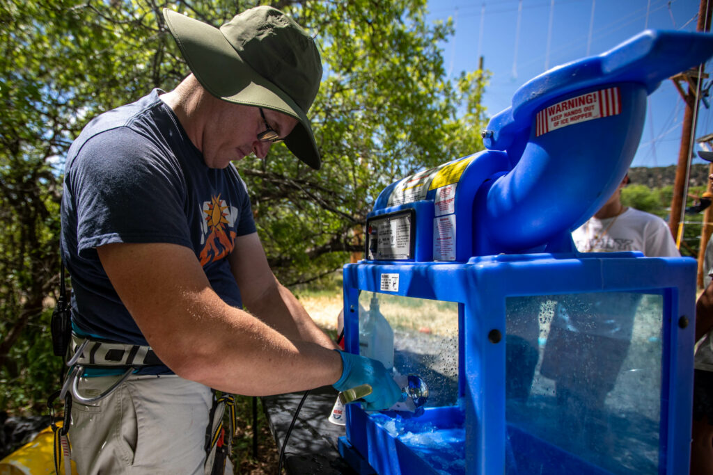 Worker Matt Johnson makes snow cones at Badger Mountain in Ephraim Canyon, Utah, for the Snow Fun! Youth Conference on Thursday, June 3, 2021.