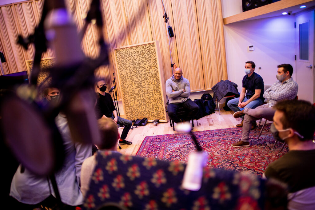 Brian Courtney Wilson chats with members of BYU Vocal Point while recording at June Audio Recording Studios in Provo on Saturday, Feb. 20, 2021.