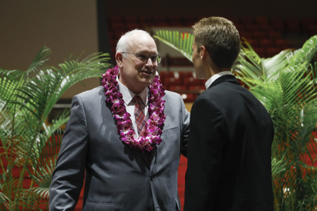 Elder Paul V. Johnson, a General Authority Seventy, speaks with an attendee after a Brigham Young University–Hawaii devotional on Tuesday, Feb. 18, 2020, in Laie, Hawaii.