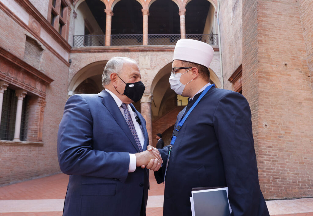 Elder Ronald A. Rasband, of The Church of Jesus Christ of Latter-day Saints' Quorum of the Twelve Apostles, talks with Imam Ahmed Tabakovic, Islamic Community of Bosnians in Italy, during the G20 Interfaith Forum in Bologna, Italy on Monday, Sept. 13, 2021.
