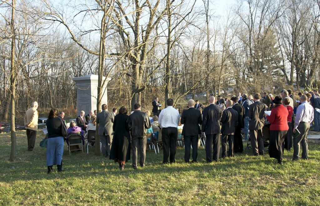 A group gathers for the dedication of the monument to the Eight Witnesses of the Book of Mormon near Liberty, Missouri, in 2011. (See Doctrine and Covenants 17.)