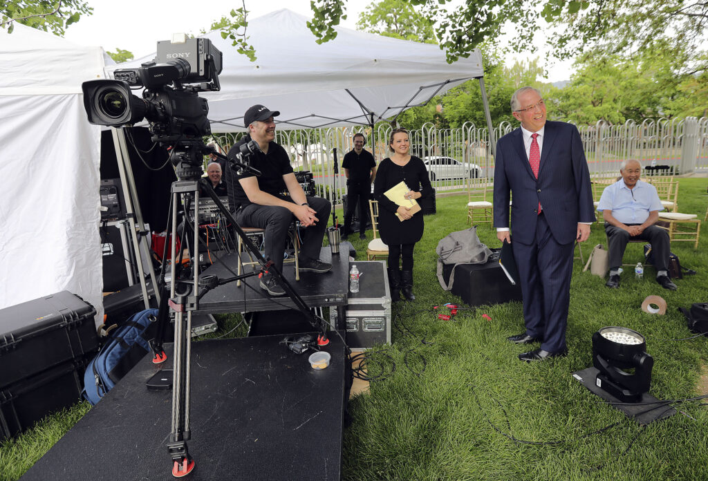 Elder Neil L. Andersen, of the Quorum of the Twelve Apostles, explores the set and talks to crew members before filming a Face to Face event for single adults age 31 and older on the Logan Utah Temple grounds in Logan on Monday, June 7, 2021.