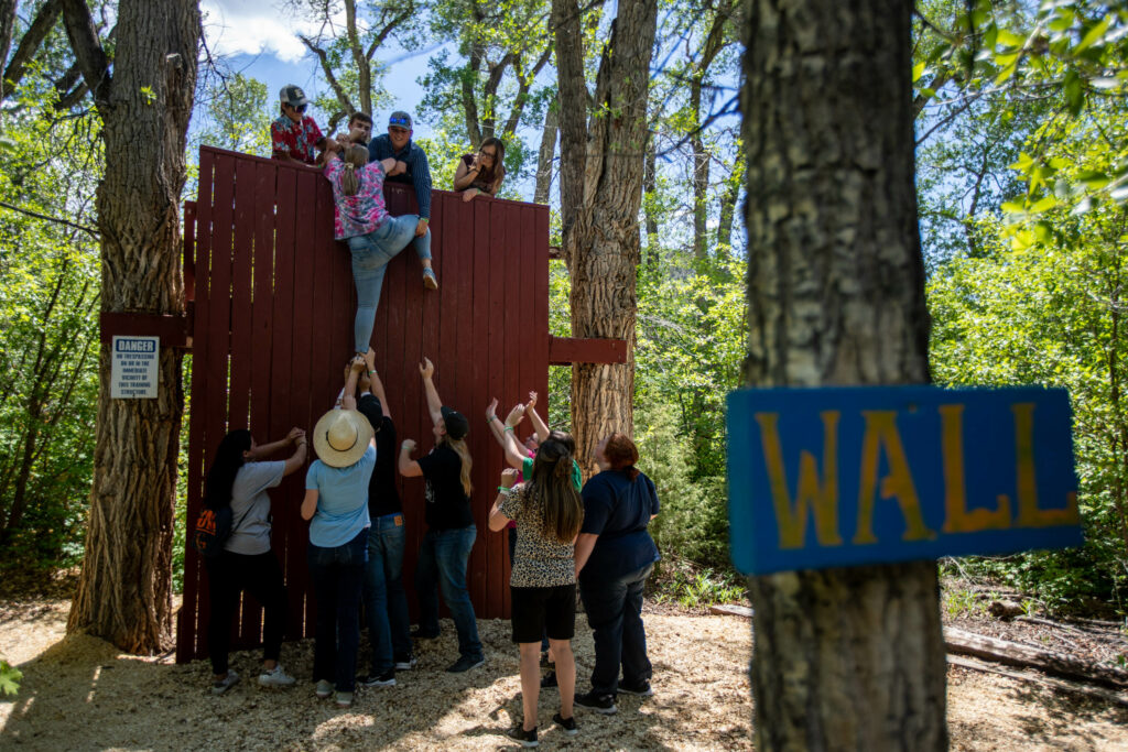 Participants take turns working as a team to hoist each other up a wall at Badger Mountain in Ephraim Canyon, Utah, for the Snow Fun! Youth Conference on Thursday, June 3, 2021.