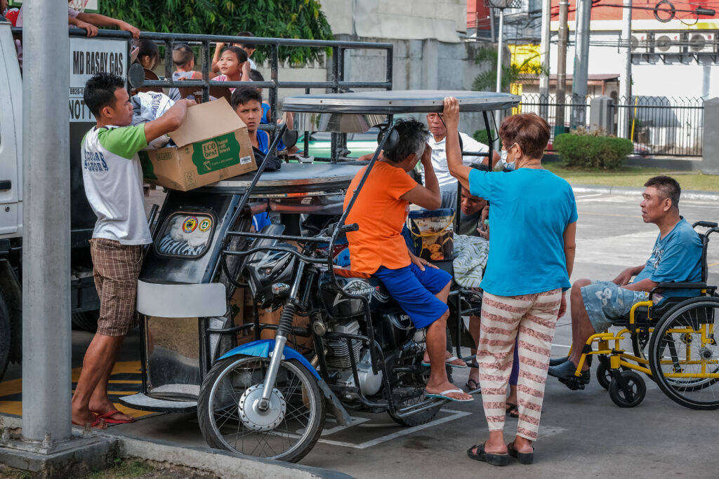 Jorge Alvarez, right, prepares to return home on Feb. 6, 2020, after spending three weeks living at the Batangas Philippines Stake Center following evacuations from the areas surrounding the Taal Volcano.