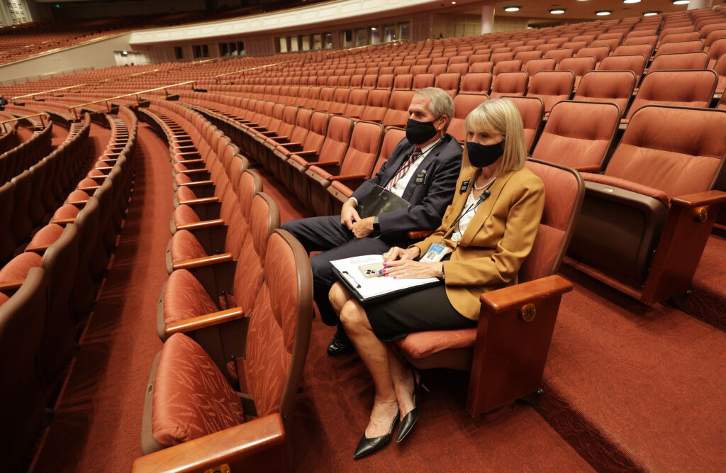 Service missionaries Mark and Janae Martin listen during the 191st General Conference of The Church of Jesus Christ of Latter-day Saints in Salt Lake City on Saturday, Oct. 2, 2021.