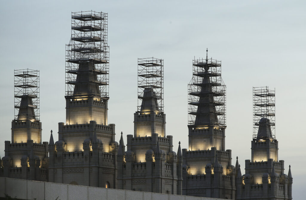 Scaffolding surrounds the spires of the Salt Lake Temple of The Church of Jesus Christ of Latter-day Saints during its renovation in Salt Lake City on Sunday, June 14, 2020.