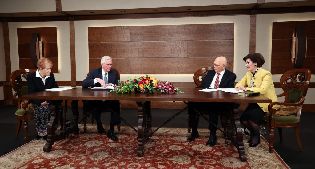 Elder D. Todd Christofferson of the Quorum of the Twelve Apostles and his wife, Sister Kathy Christofferson, left, join President Dallin H. Oaks of the First Presidency of The Church of Jesus Christ of Latter-day Saints and his wife, Sister Kristen M. Oaks, in recording a March 14 Spanish-language young adult devotional that was taped at the Church Office Building in Salt Lake City on Friday, Feb. 26, 2021.