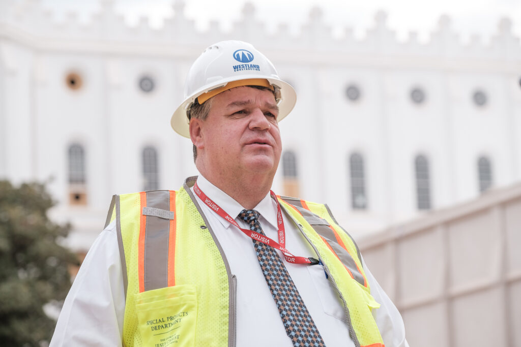 Brent Roberts, managing director of the special projects department for The Church of Jesus Christ of Latter-day Saints, talks to members of the media outside the St. George Utah Temple on Friday, Nov. 6, 2020, in St. George. The historic temple is undergoing renovations that are expected to be completed in 2022.