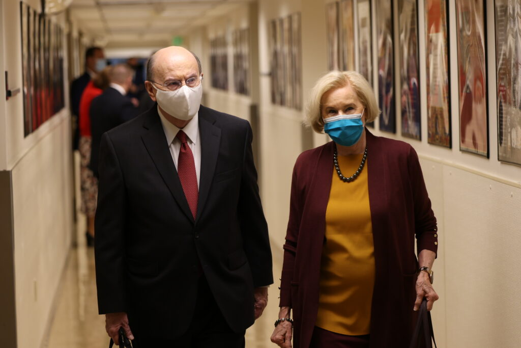 Elder Quentin L. Cook, a member of the Quorum of the Twelve Apostles ofThe Church of Jesus Christ of Latter-day Saints, and his wife, Sister Mary Cook, enter the Conference Center Theater for the church's 190th Semiannual General Conference on Saturday, Oct. 3, 2020.