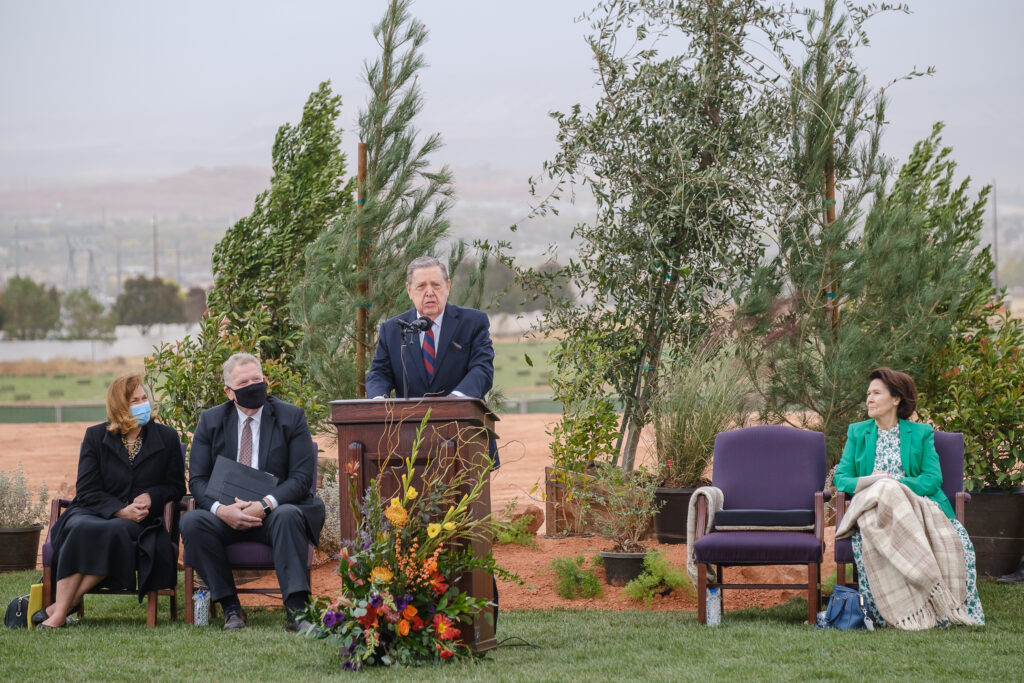 Elder Jeffrey R. Holland, Quorum of the Twelve of The Church of Jesus Christ of Latter-day Saints, speaks at the groundbreaking service for the Red Cliffs Utah Temple in St. George, Utah, Saturday, November 7, 2020. Seated behind Holland are, from left, Sister Debbie Christensen, Elder Craig C. Christensen, Utah Area President, and Sister Patricia Holland.
