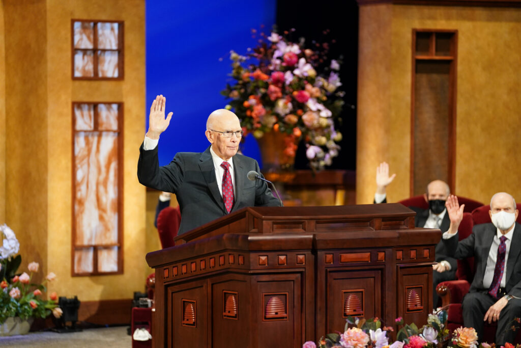 President Dallin H. Oaks, first counselor in the First Presidency, raises his hand in a sustaining vote during the Saturday afternoon session of The Church of Jesus Christ of Latter-day Saints' 191st Annual General Conference in Salt Lake City on April 3, 2021.