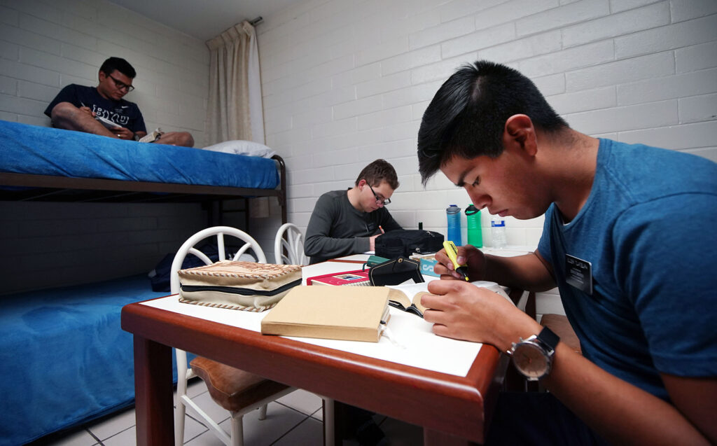 Missionaries study before going to bed at the Mexico Missionary Training Center of The Church of Jesus Christ of Latter-day Saints on Saturday, Jan. 25, 2020. At front is Elder Jack Luna Tlatelpa of Puebla, Mexico.