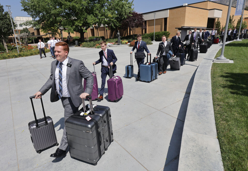 New coming missionaries carry their luggage at the Provo Missionary Training Center in Provo, Utah, on Wednesday, Aug 25, 2021.
