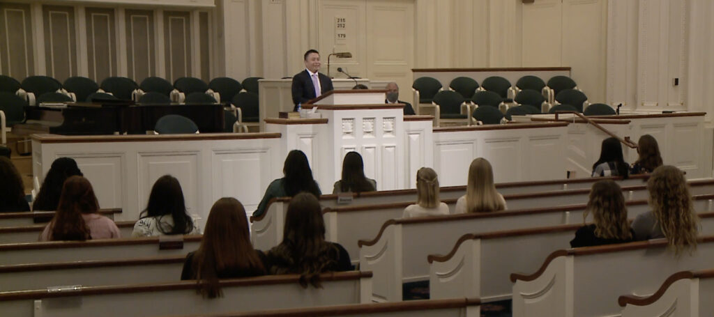 Elder Benjamin M. Z. Tai, a General Authority Seventy and an assistant executive director of the Missionary Department, conducts a missionary devotional streamed online on Jan. 14, 2021. Elder Ronald A. Rasband and Sister Melanie Rasband were the speakers, with the audience being sister missionaries of the Utah Salt Lake City Temple Square Mission.