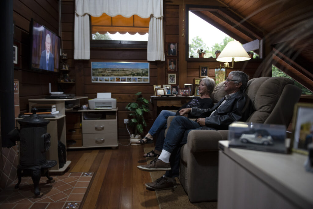 A family listens to the Saturday afternoon session of the 190th Semiannual General Conference of The Church of Jesus Christ of Latter-day Saints on Oct. 3, 2020.